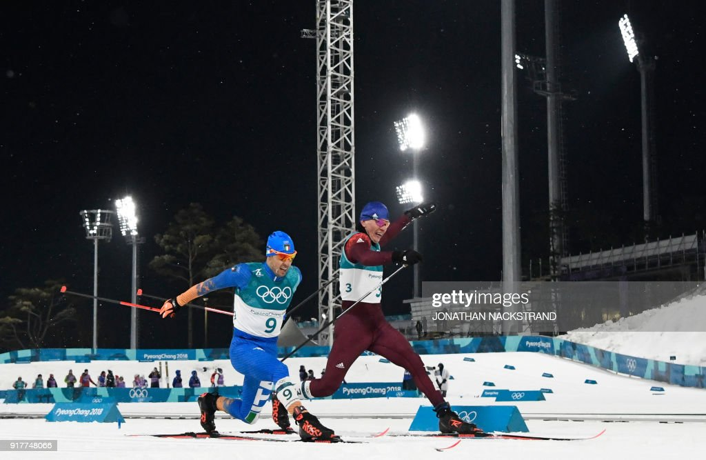 TOPSHOT - Italy's Federico Pellegrino (L) snatches silver and Russia's Alexander Bolshunov, bronze, as the cross the finish line in the men's cross-country individual sprint classic final at the Alpensia cross country ski centre during the Pyeongchang 2018 Winter Olympic Games on February 13, 2018 in Pyeongchang. / AFP PHOTO / Jonathan NACKSTRAND