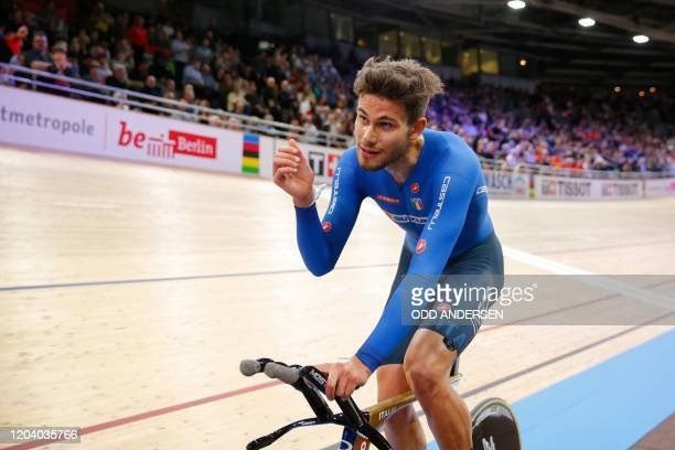 Italy's Filippo Ganna celebrates Gold in the men's individual pursuit final at the UCI track cycling World Championship at the velodrome in Berlin on...