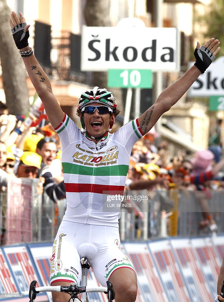 Italy's Filippo Pozzato (Katusha) celebrates as he crosses the finish line of the 12th stage of the 93rd Giro d'talia, from Citta Sant'Angelo to Porto Recanati, on May 20, 2010. Italy's Filippo Pozzato won Thursday's 12th stage of the Tour of Italy with Australian Riche Porte holding on to the leader's pink jersey. AFP PHOTO / Luk Beines