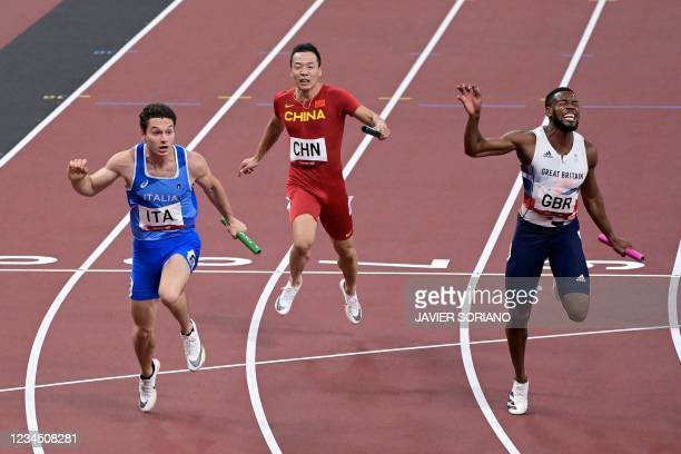 Italy's Filippo Tortu crossed the finish line to win ahead of China's Wu Zhiqiang and Britain's Nethaneel Mitchell-Blake in the men's 4x100m relay...