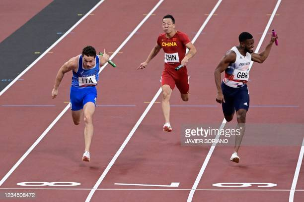 Italy's Filippo Tortu crosses the finish line to win ahead of China's Wu Zhiqiang and Britain's Nethaneel Mitchell-Blake in the men's 4x100m relay...