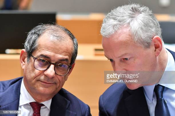 Italy's Finance Minister Giovanni Tria reacts as he listens to France's Finance Minister Bruno Le Maire while they attend a Eurogroup Finance...