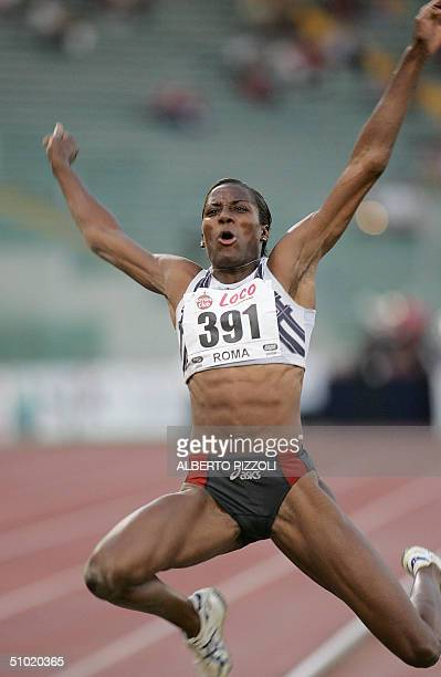 Italy's Fiona May vies in the long jump in the Golden Gala of Athletics meet in Rome Olympic Stadium 02 July 2004