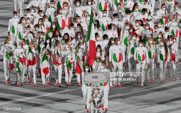 Italy's flag bearer Jessica Rossi and Italy's flag bearer Elia Viviani lead the delegation during the opening ceremony of the Tokyo 2020 Olympic...