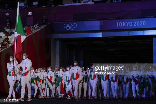 Italy's flag bearers Jessica Rossi and Elia Viviani lead their delegation during the Tokyo 2020 Olympic Games opening ceremony's parade of athletes,...
