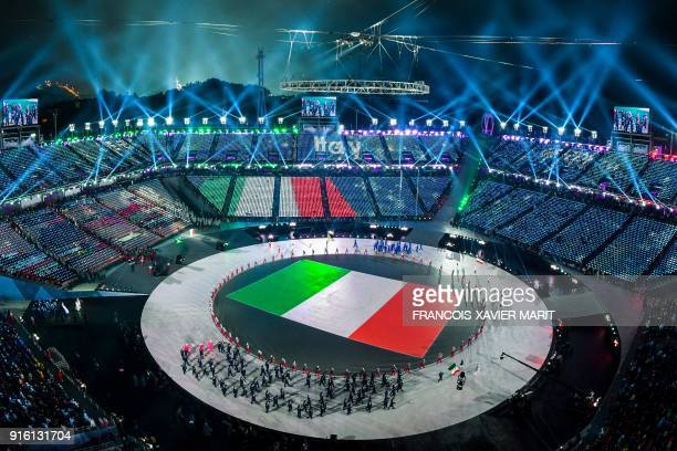 Italy's flag is seen during the opening ceremony of the Pyeongchang 2018 Winter Olympic Games at the Pyeongchang Stadium on February 9 2018 / AFP...