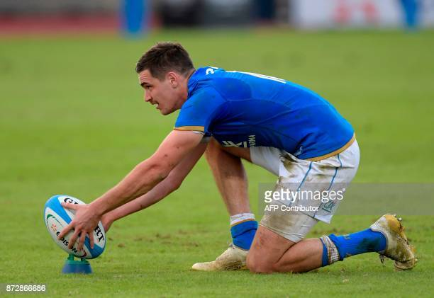 Italy's flyhalf Carlo Canna prepares the ball to kick a penalty during the international rugby union Test match between Italy and Fiji at The Angelo...