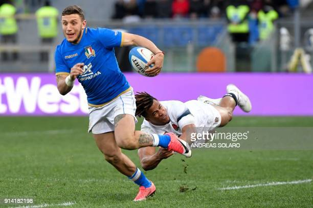 TOPSHOT Italy's flyhalf Matteo Minozzi vies for the ball with England's wing Anthony Watson during the Six Nations rugby union match between Italy...