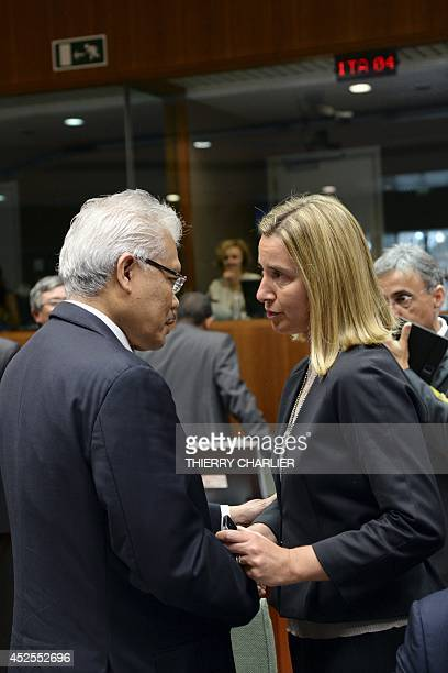 Italy's Foreign Minister Federica Mogherini confers with Malaysia's Deputy Foreign Minister Datuk Hamzah Zainudin prior to a meeting of Foreign...
