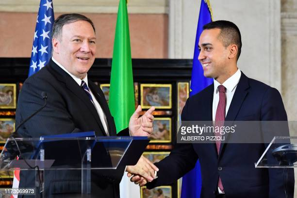 Italy's Foreign Minister Luigi Di Maio and US Secretary of State Mike Pompeo shake hands within a joint press conference following their meeting at...