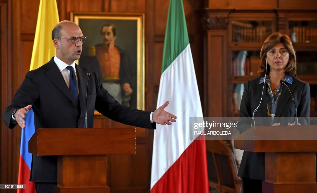 Italy's Foreing Minister Angelino Alfano delivers a speech at a joint press conference with Colombia's Foreign Minister Maria Angela Holguin at San Carlos palace in Bogota, on February 20, 2018. Alfano is in the country to strengthen post-conflict support. / AFP PHOTO / Raul ARBOLEDA