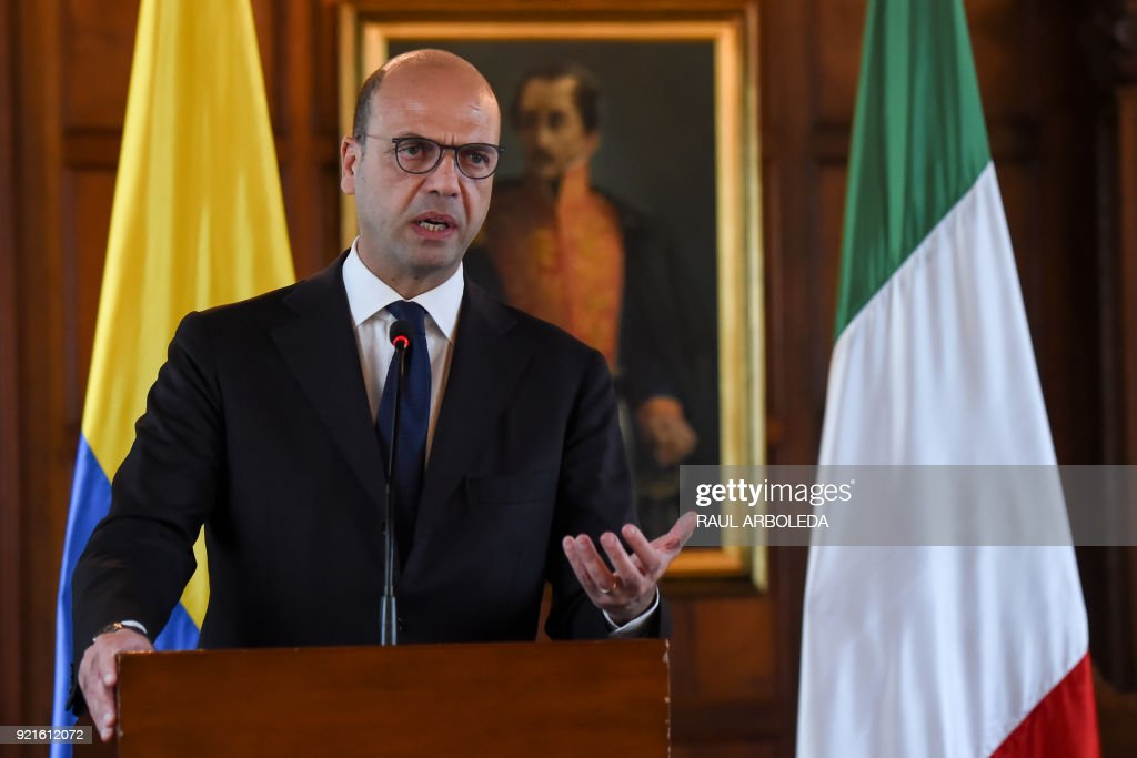 Italy's Foreing Minister Angelino Alfano delivers a speech at a joint press conference with Colombia's Foreign Minister Maria Angela Holguin (not in frame) at San Carlos palace in Bogota, on February 20, 2018. Alfano is in the country to strengthen post-conflict support. / AFP PHOTO / Raul ARBOLEDA