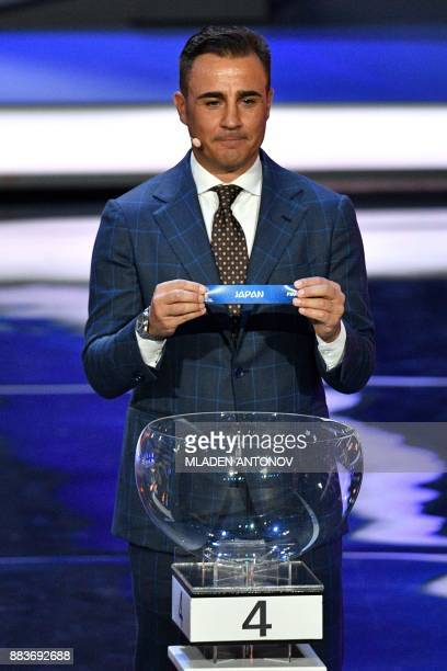 Italy's former defender and Guangzhou Evergrande's coach Fabio Cannavaro displays the slip of Japan during the Final Draw for the 2018 FIFA World Cup...