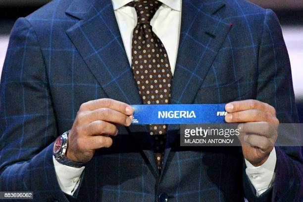 Italy's former defender and Guangzhou Evergrande's coach Fabio Cannavaro displays the slip of Nigeria during the Final Draw for the 2018 FIFA World...