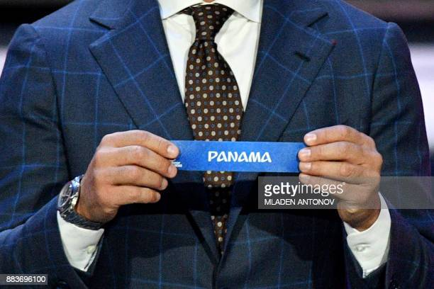 Italy's former defender and Guangzhou Evergrande's coach Fabio Cannavaro displays the slip of Panama during the Final Draw for the 2018 FIFA World...