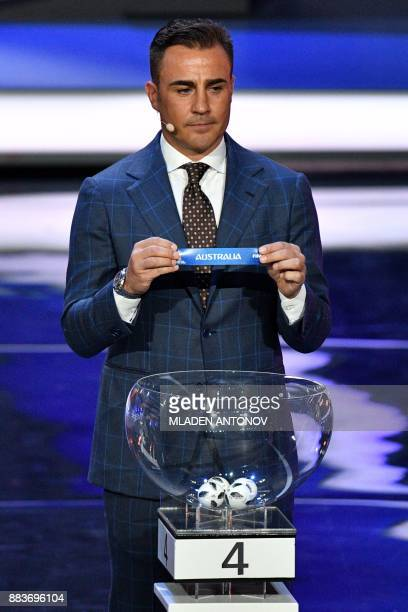 Italy's former defender and Guangzhou Evergrande's coach Fabio Cannavaro displays the slip of Australia during the Final Draw for the 2018 FIFA World...