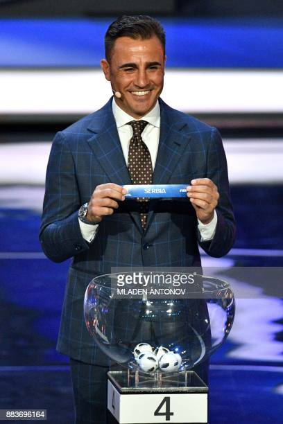 Italy's former defender and Guangzhou Evergrande's coach Fabio Cannavaro displays the slip of Serbia during the Final Draw for the 2018 FIFA World...