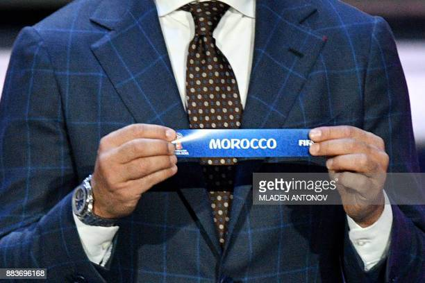Italy's former defender and Guangzhou Evergrande's coach Fabio Cannavaro displays the slip of Morocco during the Final Draw for the 2018 FIFA World...