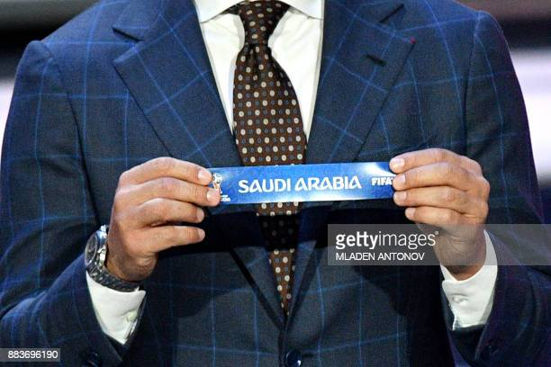 Italy's former defender and Guangzhou Evergrande's coach Fabio Cannavaro displays the slip of Saudi Arabia during the Final Draw for the 2018 FIFA...