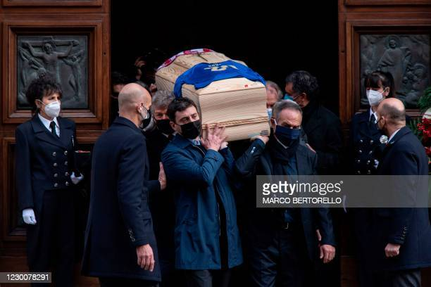 Italy's former football player Antonio Cabrini and the son of Paolo Rossi, Alessandro Rossi , carry the coffin of the late Italian football player...