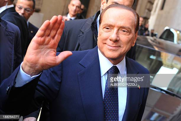 Italy's former Prime Minister and head of the Popola della Liberta delegation at the lowerhouse Silvio Berlusconi arrives at the parliament ahead of...
