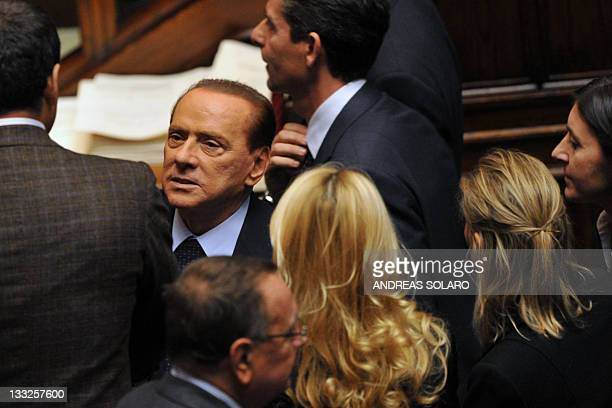 Italy's former Prime minister and head of the Popola della liberta party's group at the lowerhouse Silvio Berlusconi listens to deputies during a...