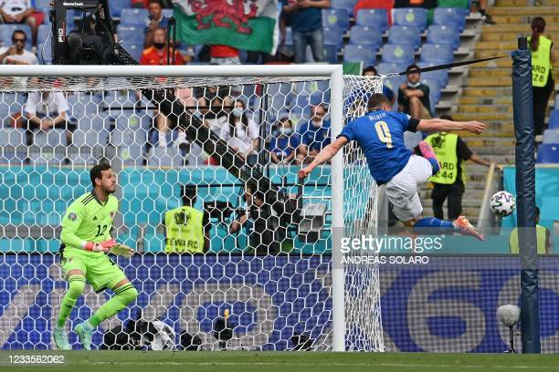 Italy's forward Andrea Belotti attempts to reach the ball during the UEFA EURO 2020 Group A football match between Italy and Wales at the Olympic...