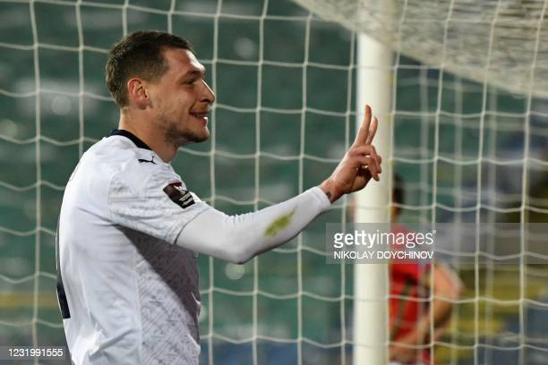 Italy's forward Andrea Belotti celebrates after scoring on a penalty kick during the FIFA World Cup Qatar 2022 qualification Group C football match...