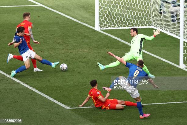 Italy's forward Andrea Belotti shoots the ball wide during the UEFA EURO 2020 Group A football match between Italy and Wales at the Olympic Stadium...