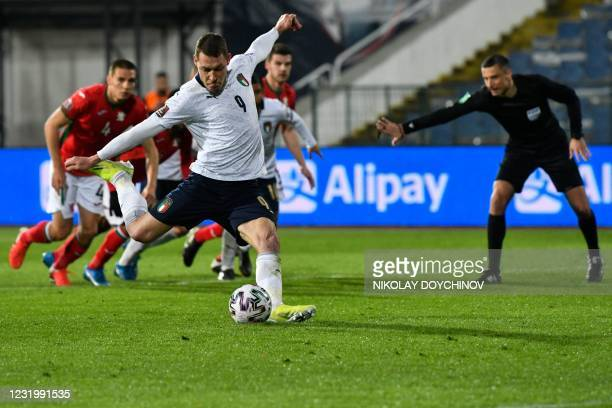 Italy's forward Andrea Belotti takes a penalty kick during the FIFA World Cup Qatar 2022 qualification Group C football match between Bulgaria and...