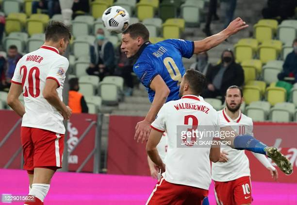 Italy's forward Andrea Belotti vies for the ball with Poland's midfielder Jakub Moder and Poland's defender Sebastian Walukiewicz vie for the ball...