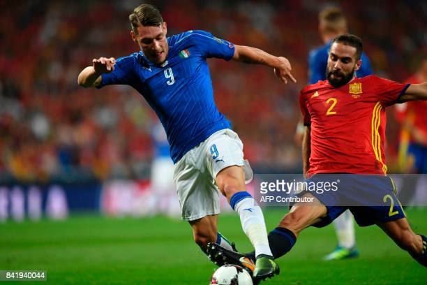 Italy's forward Andrea Belotti vies with Spain's defender Dani Carvajal during the World Cup 2018 qualifier football match Spain vs Italy at the...