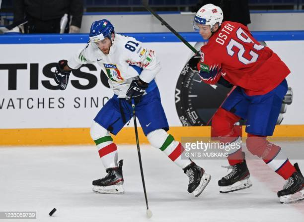 Italy's forward Anthony Bardaro and Norway's defender Kristian Ostby vie during the IIHF Men's Ice Hockey World Championships preliminary round group...