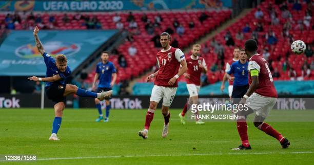 Italy's forward Ciro Immobile attempts a shot during the UEFA EURO 2020 round of 16 football match between Italy and Austria at Wembley Stadium in...