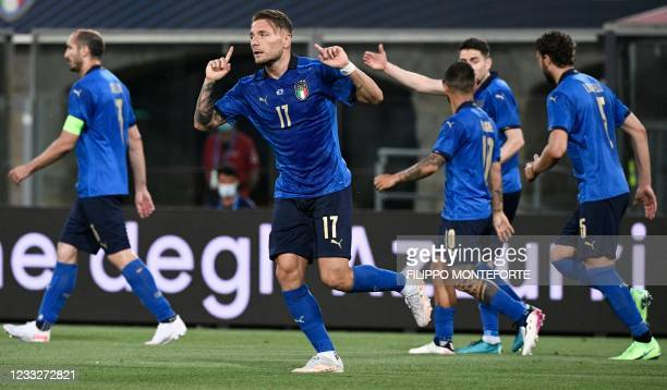 Italy's forward Ciro Immobile celebrates after opening the scoring on June 04, 2021 during the international friendly football match between Italy...