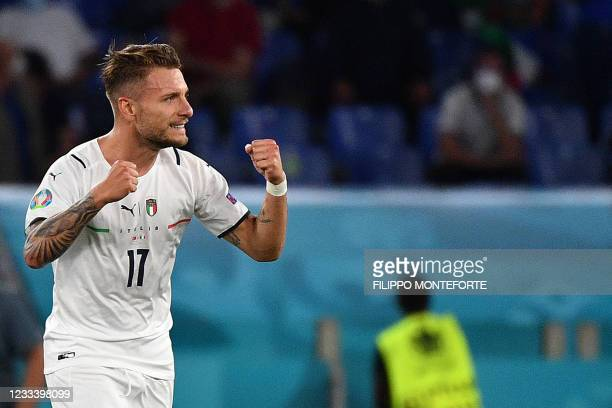 Italy's forward Ciro Immobile celebrates scoring a goal during the UEFA EURO 2020 Group A football match between Turkey and Italy at the Olympic...