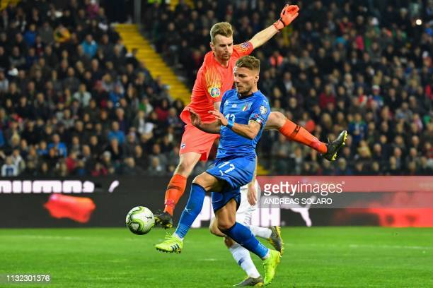 Italy's forward Ciro Immobile challenges Finland's goalkeeper Lucas Hradecky during the Euro 2020 Group J qualifying football match between Italy and...