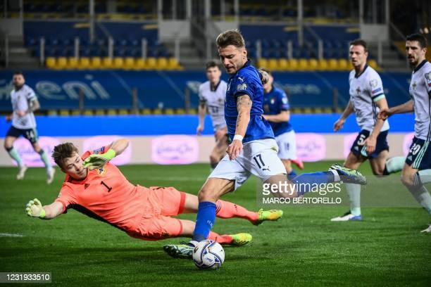 Italy's forward Ciro Immobile challenges Northern Ireland's goalkeeper Bailey Peacock-Farrell as he attempts to shoot on target during the FIFA World...
