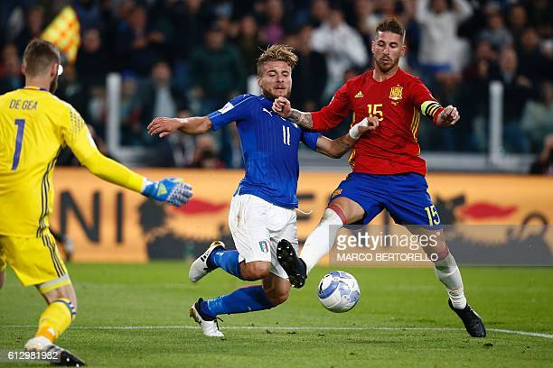 Italy's forward Ciro Immobile fights for the ball with Spain's defender Sergio Ramos in front of Spain's goalkeeper David de Gea during the WC 2018...