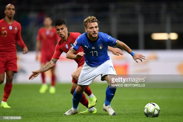 Italy's forward Ciro Immobile outruns Portugal's defender Joao Cancelo during the UEFA Nations League group 3 football match Italy vs Portugal at the...