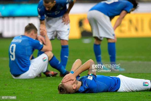 Italy's forward Ciro Immobile react at the end of the FIFA World Cup 2018 qualification football match between Italy and Sweden, on November 13, 2017...