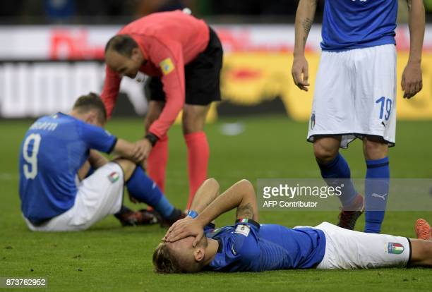 TOPSHOT Italy's forward Ciro Immobile reacts at the end of the FIFA World Cup 2018 qualification football match between Italy and Sweden on November...