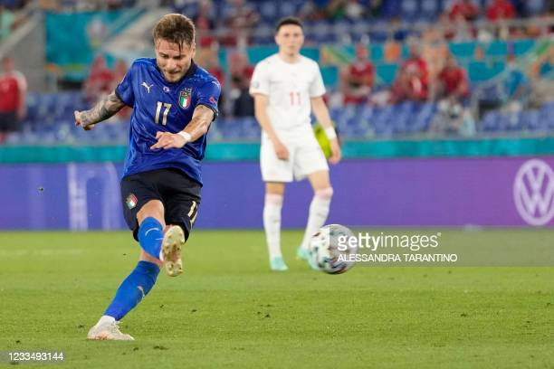 Italy's forward Ciro Immobile shoots to score the team's third goal during the UEFA EURO 2020 Group A football match between Italy and Switzerland at...
