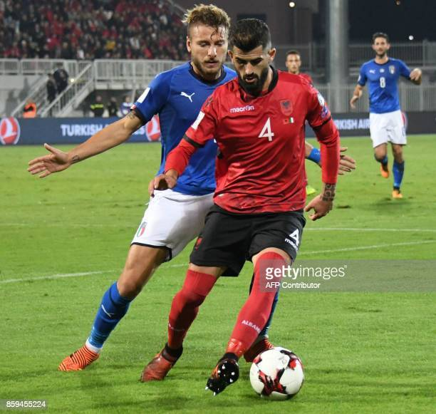 Italy's forward Ciro Immobile vies with Albania's defender Eseid Hysaj during the FIFA World Cup 2018 qualification football match between Albania...