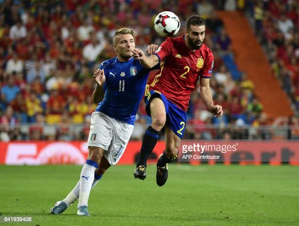 Italy's forward Ciro Immobile vies with Spain's defender Dani Carvajal during the World Cup 2018 qualifier football match between Spain and Italy at...