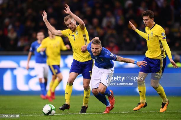 Italy's forward Ciro Immobile vies with Sweden's midfielder Sebastian Larsson and Sweden's defender Victor Lindeloef during the FIFA World Cup 2018...