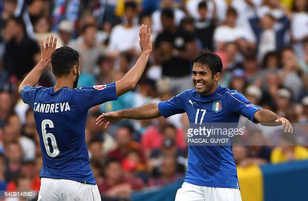 Italy's forward Citadin Martins Eder celebrates a goal with Italy's midfielder Antonio Candreva during the Euro 2016 group E football match between...