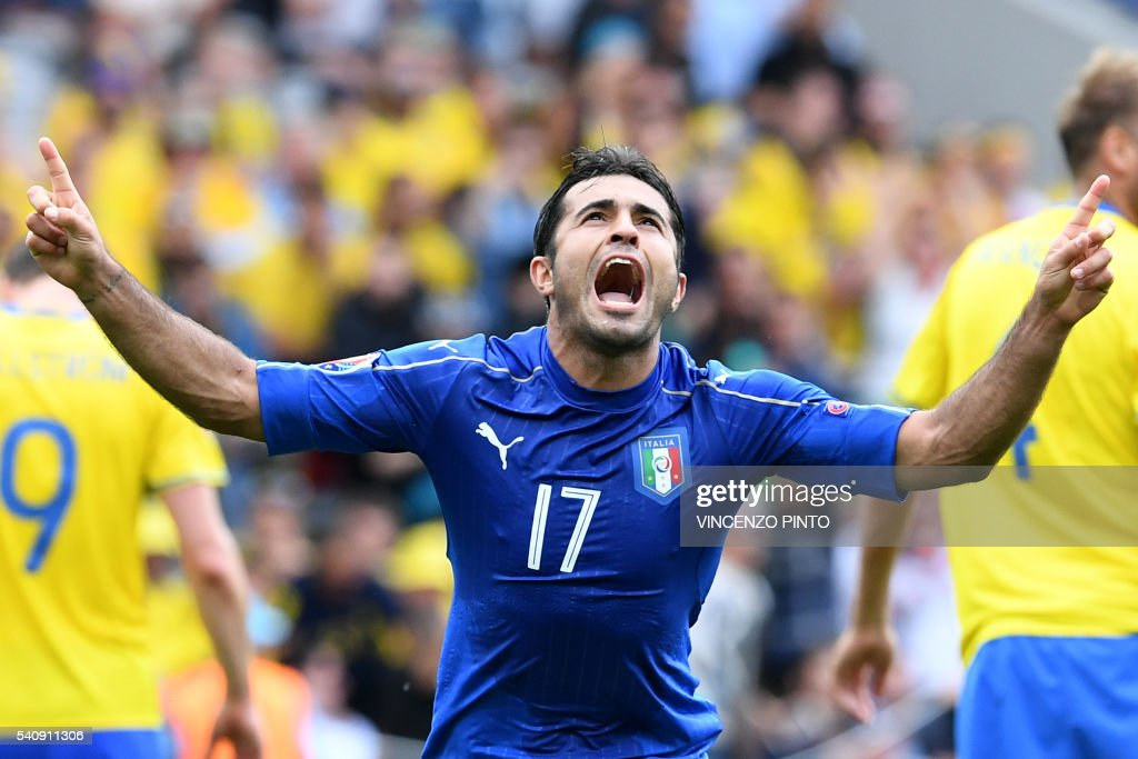 TOPSHOT - Italy's forward Citadin Martins Eder celebrates after scoring during the Euro 2016 group E football match between Italy and Sweden at the Stadium Municipal in Toulouse on June 17, 2016. /