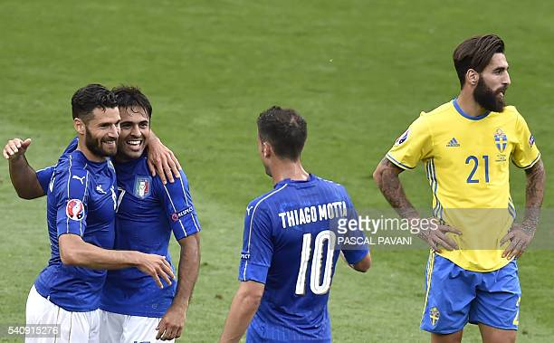 Italy's forward Citadin Martins Eder celebrates with teammates beside Sweden's midfielder Jimmy Durmaz at the end of the Euro 2016 group E football...