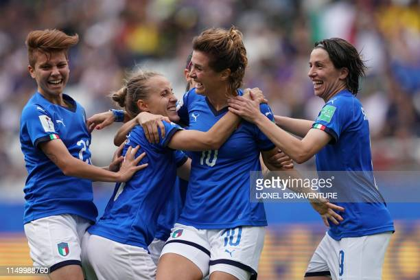 TOPSHOT Italy's forward Cristiana Girelli is congratulated by teammates after scoring her third goal during the France 2019 Women's World Cup Group C...